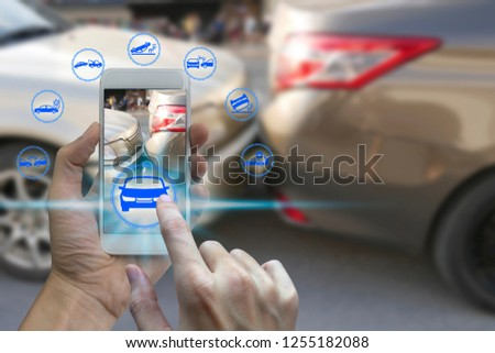 Hand use smartphone with car claim icons over the Network connection on car crash background, car accident for car insuranc claim concept. #1255182088