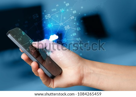 Hand using phone with cloud computing and online storage concept #1084265459