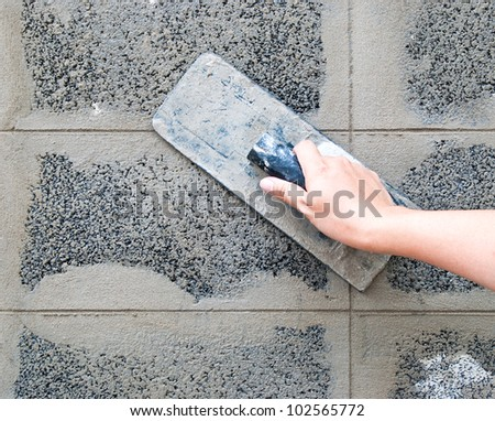 Hand using trowel