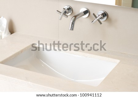 Hand wash basin with faucet