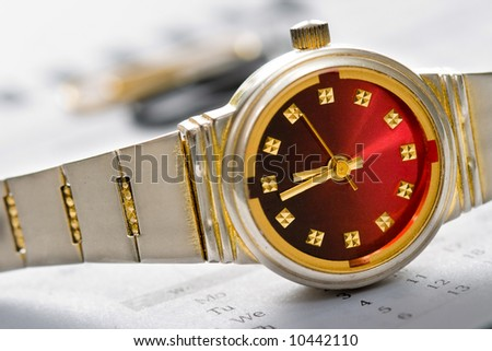 hand watch time concept with calendar bottom