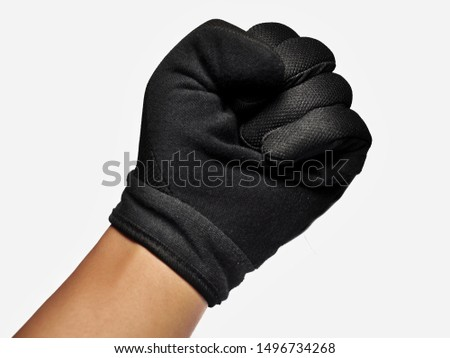 Hand wearing black glove with action gesture isolated on white background