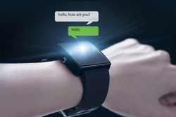 Hand wearing smartwatch. A smartwatch is a wearable computing device that closely resembles a wristwatch or other time-keeping device.