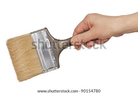hand with a brush isolated on white background