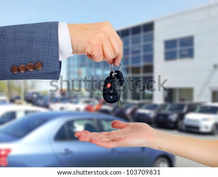 Hand with a Car keys. Transportation background.