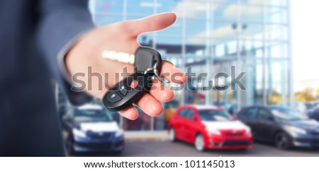 Hand with a Car keys. Transportation. Driving. - stock photo