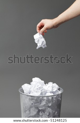stock-photo-hand-with-a-crumpled-paper-and-a-waste-paper-basket-51248125.jpg