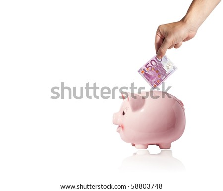Hand with a five hundred euros bank note over a piggy bank on white background with reflection