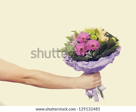 hand with a flowers isolated on white