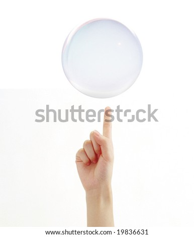 Hand with a hovering crystal ball on it