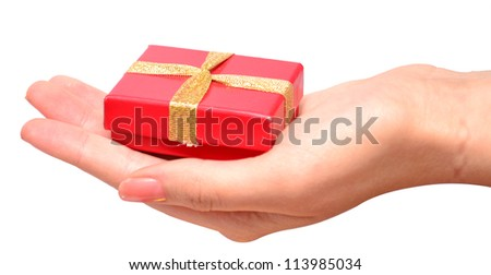 Hand with a small red gift box with gold bow isolated on white background