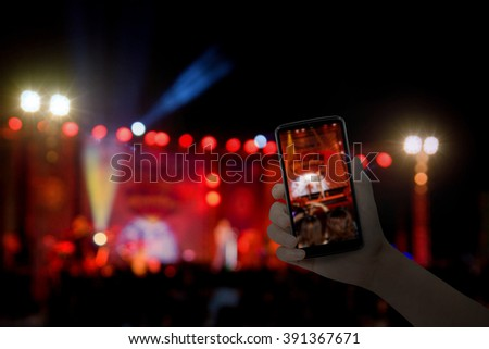 Hand with a smartphone records live music festival, live concert, live concert. #391367671