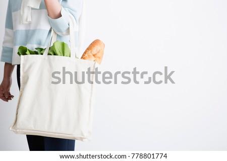 Hand with an eco bag  #778801774
