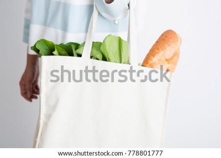 Hand with an eco bag  #778801777