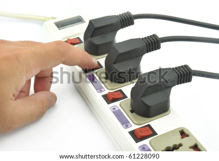 Hand with an electric plug and socket is isolated over white