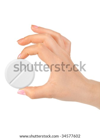 Hand with big pill isolated on white background