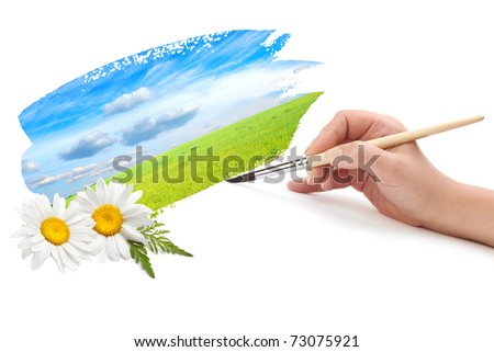 hand with brush and landscape
