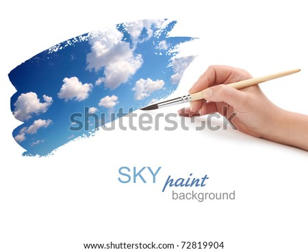 hand with brush and sky paint