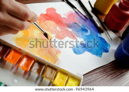 hand with brush, drawing abstract picture