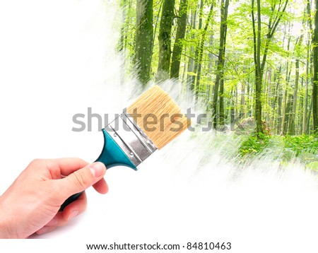 Hand with brush painting summer forest.