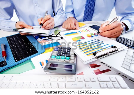 Shutterstock Hand with calculator. Finance and accounting business.