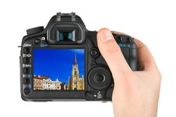 Hand with camera and Novi Sad - Serbia image (my photo) isolated on white background