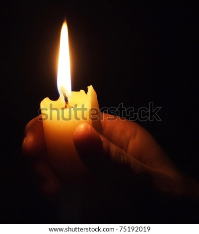 hand with candle - stock photo