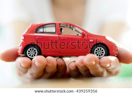 Hand with car. Auto dealership and rental concept background. #439259356