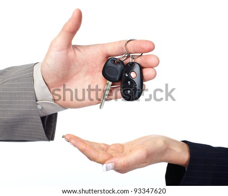 Hand with Car key. Isolated over white background.
