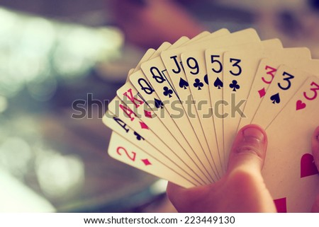 hand with cards vintage color tone