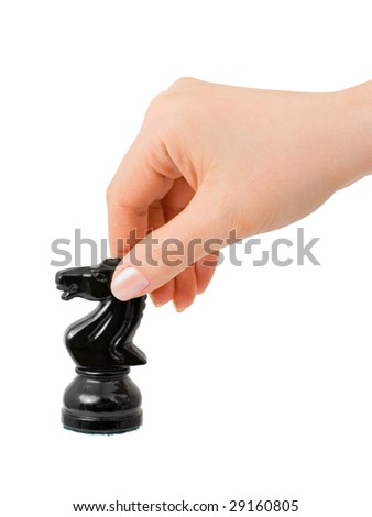 Hand with chess knight isolated on white background