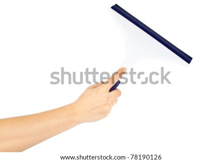 Hand with cleaning tool - stock photo