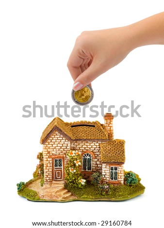Hand with coin and house bank isolated on white background