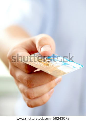 Hand with credit card. Shallow DOF
