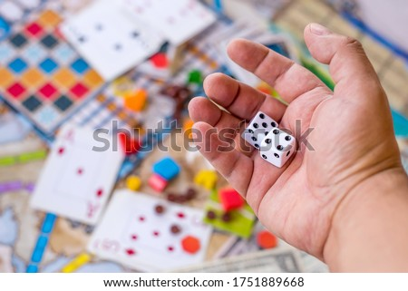 Hand with dice playing board games - luck, gambling Photo stock ©