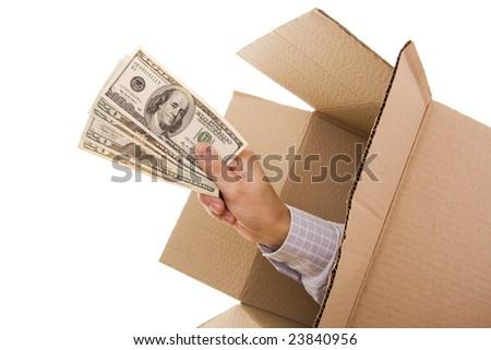 Hand with dollars inside a cardboard box - stock photo