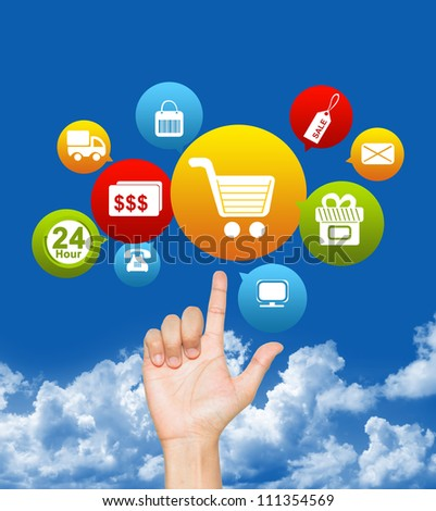 Hand With E-Commerce Icon Above in Blue Sky Background For Internet and Online Shopping Concept