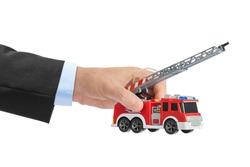 Hand with fire truck isolated on white background