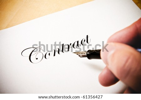 Hand with fountain peen signing a contract in color - stock photo