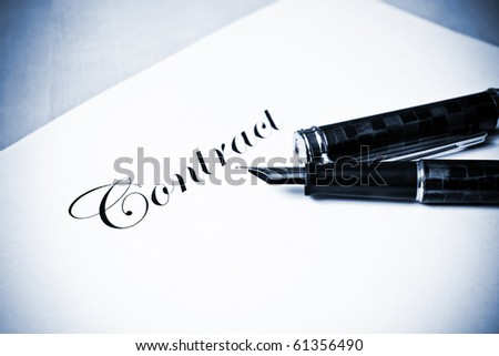 Hand with fountain pen signing a contract in blue tone