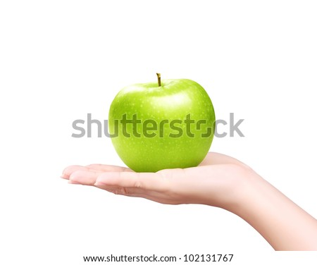 hand with green apple isolated on white background