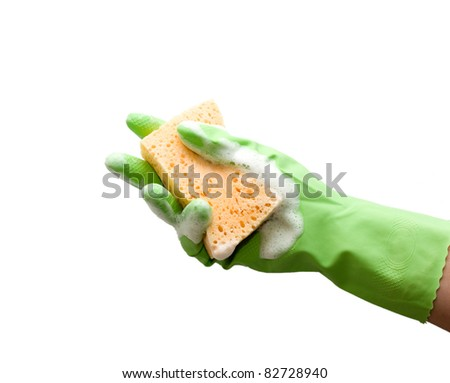 Hand with green glove holding foamy cleaning sponge; isolated on white