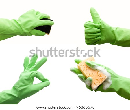 Hand with green glove holding foamy cleaning sponge isolated on white - stock photo
