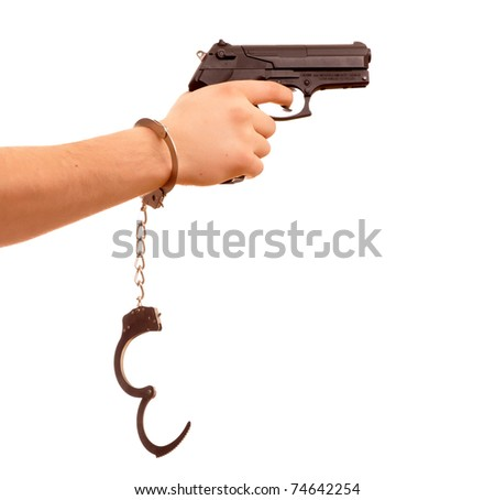hand with gun and handcuff isolated on white background