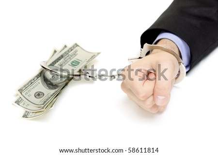 Hand with handcuffs and US dollars isolated against white background
