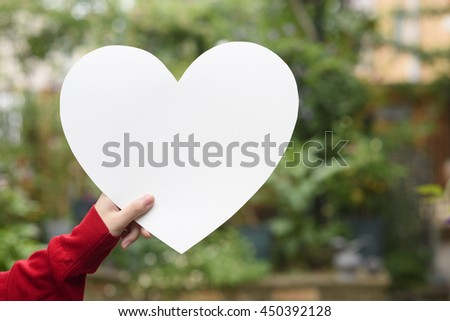 Hand with heart #450392128