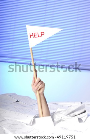 hand with help flag sticking out of a desk full of papers