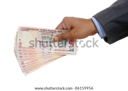 Hand with Indian thousand rupee notes.