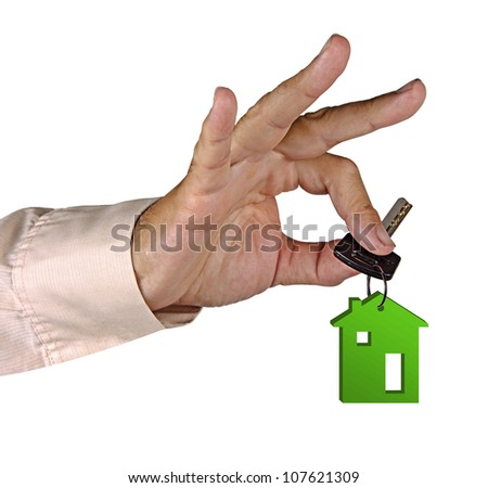 Hand with key - stock photo
