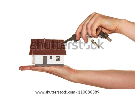 Hand with keys and little house / dream of own house - stock photo